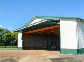 Open bi-fold door on ag building
