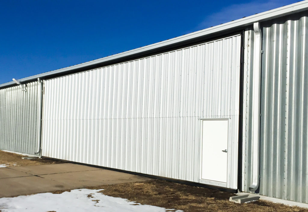 White bi-fold hangar door