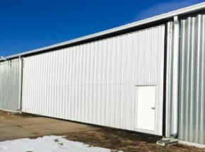 White bi-fold hangar door