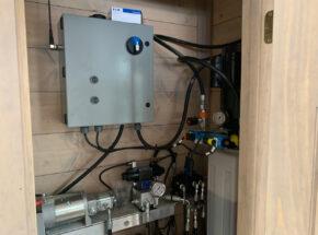 Architectural hydraulic door control box